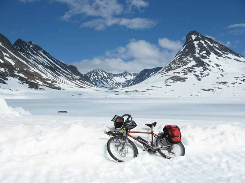 My bike amongst snow and mountains